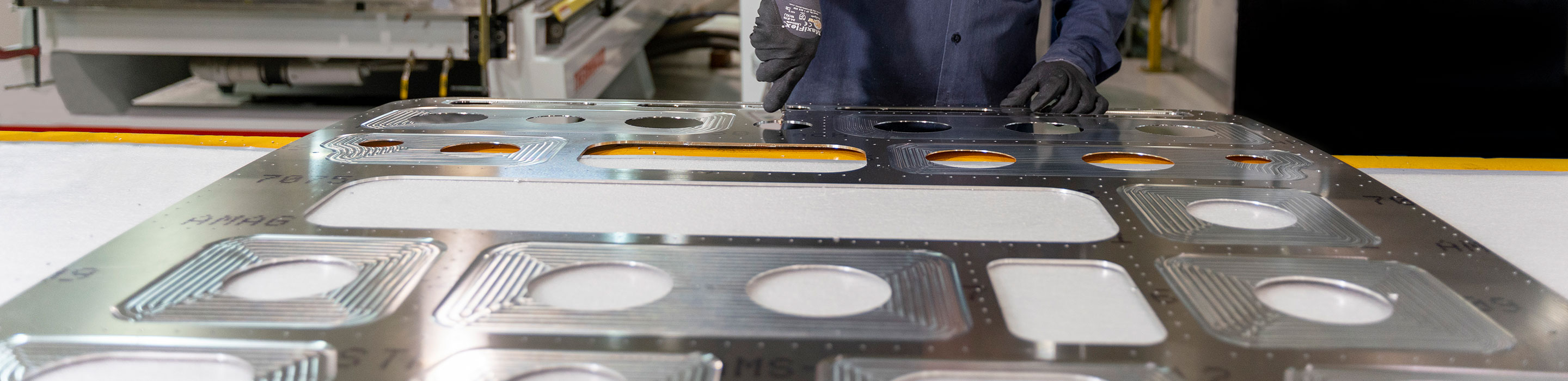 Person operating a mold for sheet metal