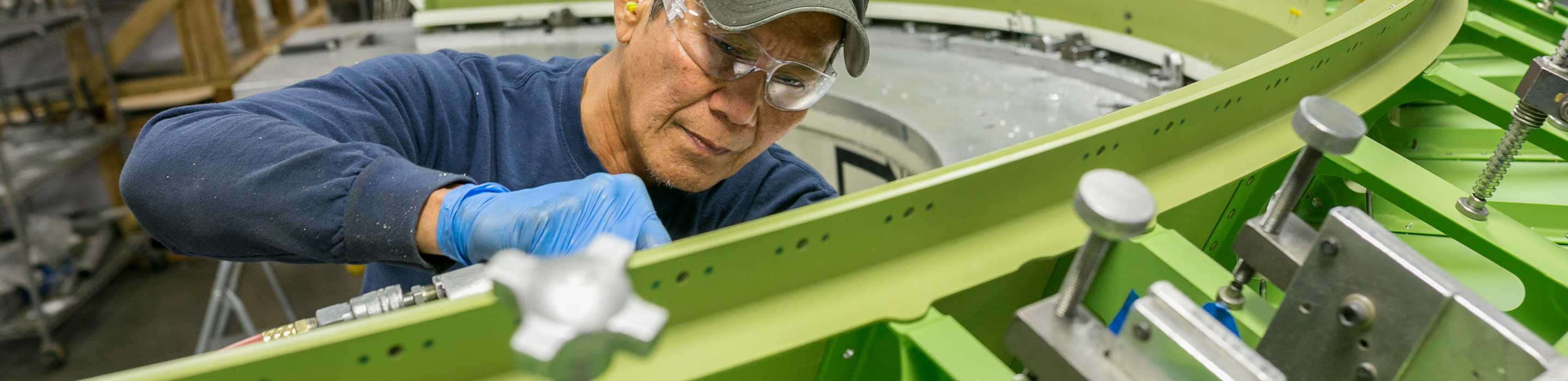 Man working on interior of bulkhead assembly
